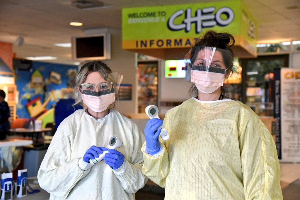 CHEO staff in masks and gowns, ready to screen those entering the building!