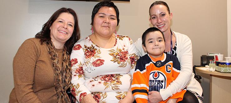 Carolyn Roberts, Nina Kautuk, her son Jutanie, and Kerri-Lynn Whyte