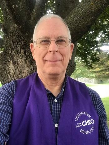 Rick Patch in purple volunteer vest