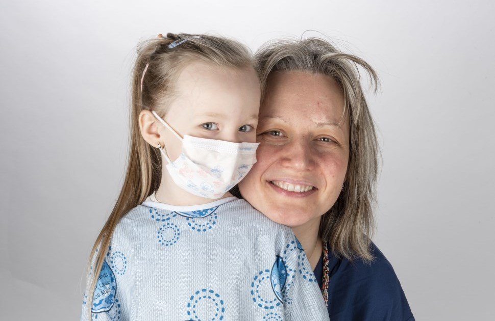 Daughter in a hospital gown with her mother
